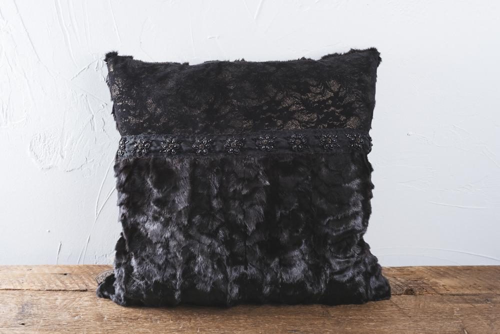 This Baroque cushion made of black mink deep and leather stripes will seduce you. The back is made out of genuine mink . Dimensions 45x45 cm .